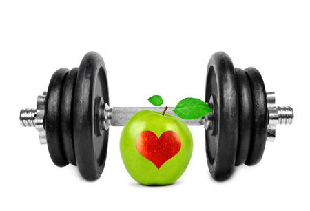 Black dumbbell with apple on white background  photo