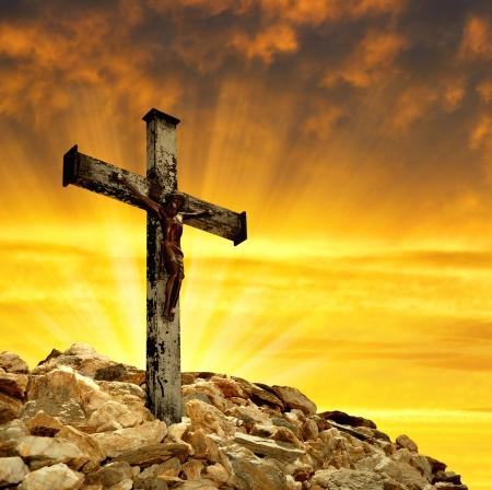 christian trust: Jesus Christ on The Cross in the sunset  Stock Photo