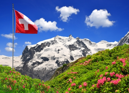 Mount Monte Rosa with Swiss flag - Swiss Alps  photo