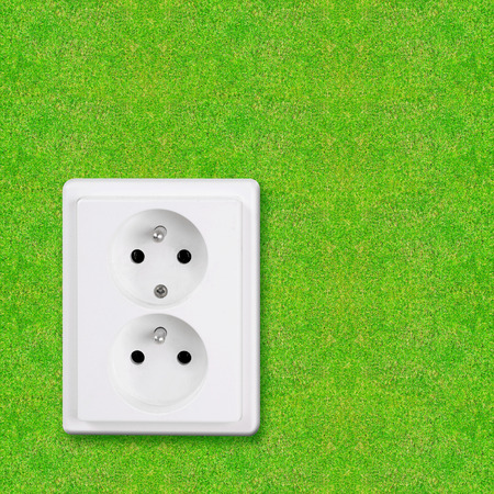 technolgy: power socket embedded in green grass