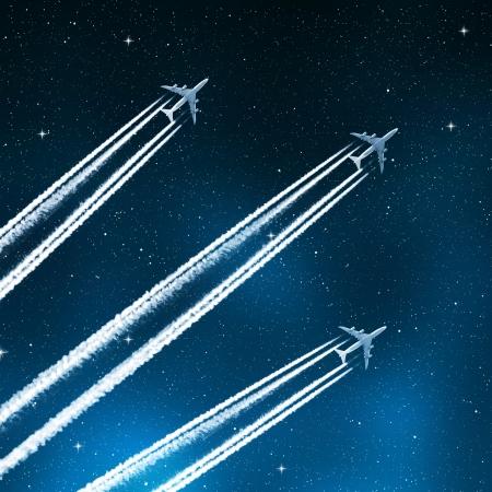 jet stream: aviones en el cielo nocturno Foto de archivo