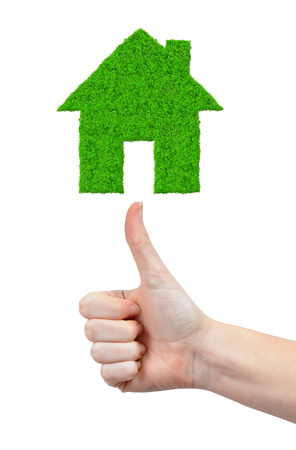 Green house symbol and Hand with thumb up photo
