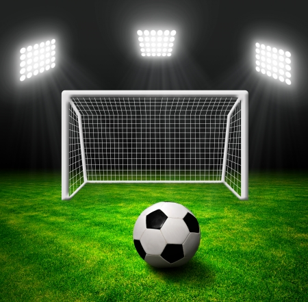 football match lawns: Soccer ball in grass, soccer stadium with the dright lights   Stock Photo