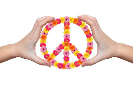 Peace flower symbol in hands  photo