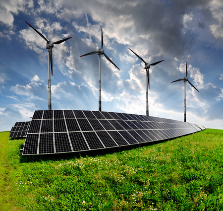 silicium: solar energy panels and wind turbines in the sunset Stock Photo