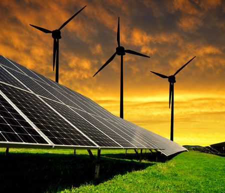solar wind: Solar energy panels with wind turbines in the setting sun