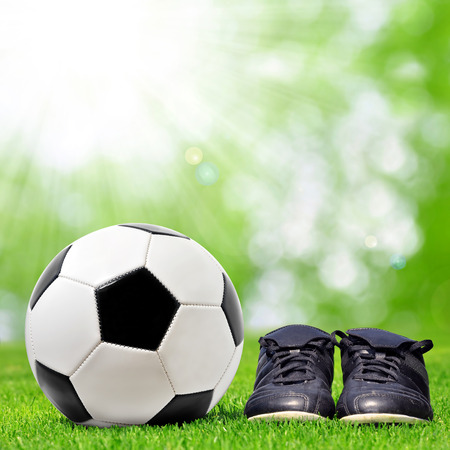 soccer boots: Soccer ball and soccer boots lying on the playground