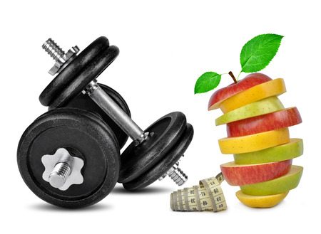 Black dumbbells with apple mix isolated on white  photo