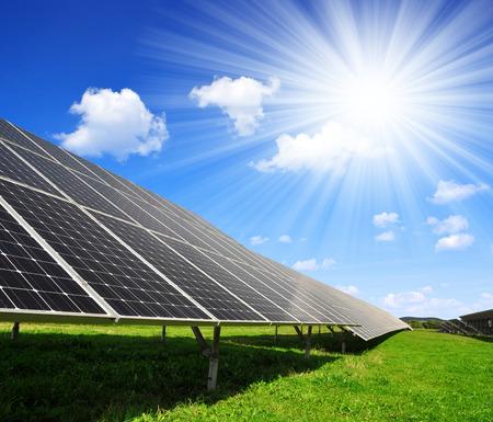 electricity generation: Solar energy panels against sunny sky