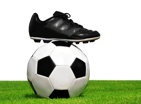 soccer cleats: soccer ball and shoes in grass isolated on white background