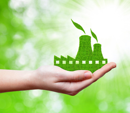 nuclear power station: Green Nuclear power plant icon in hand