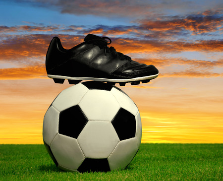 football shoes: soccer ball and shoes in grass