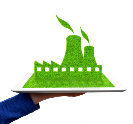 hand holding a tablet with Green Nuclear power plant icon  Stock Photo - 27924474