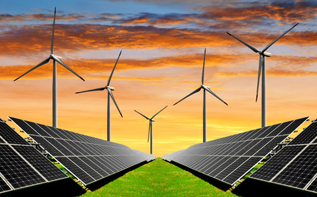 Solar energy panels with wind turbines in the setting sun photo