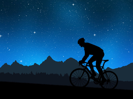 silhouette of the cyclist riding a road bike in night photo