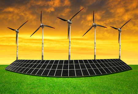 solar energy panels and wind turbines in the sunset photo