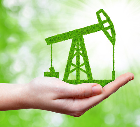 Green oil pump in hand photo
