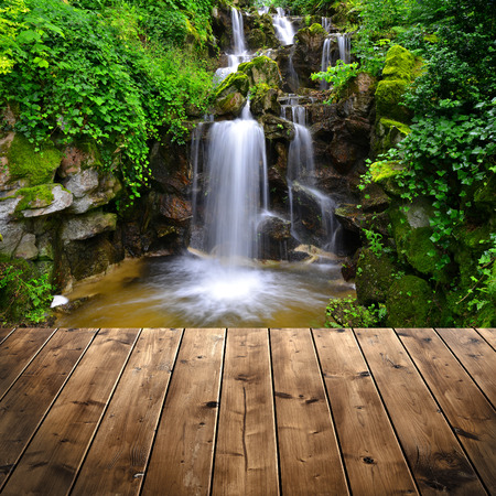 spruit: Beautiful waterfall with wooden plank