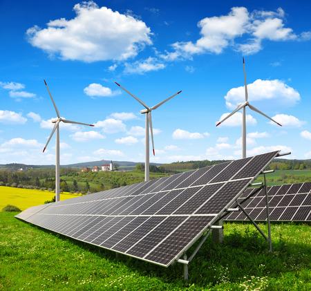 energy saving: Paneles de energía solar y turbinas de viento Foto de archivo