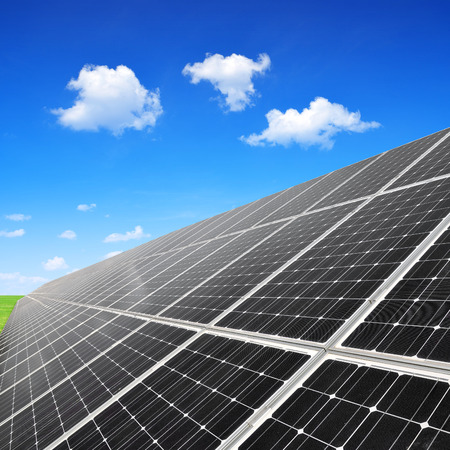 silicium: Solar panels against blue sky with clouds