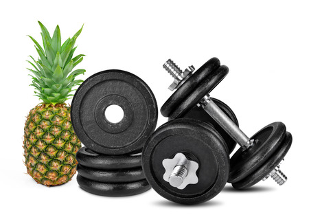 Black dumbbells with pineapple isolated on white  photo