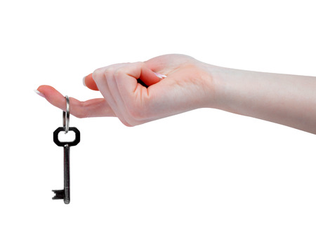 Hand and key isolated on white background  photo