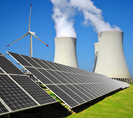Solar energy panels, wind turbine and nuclear power plant photo