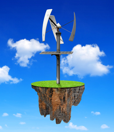 recluse: Little island with wind turbine Stock Photo