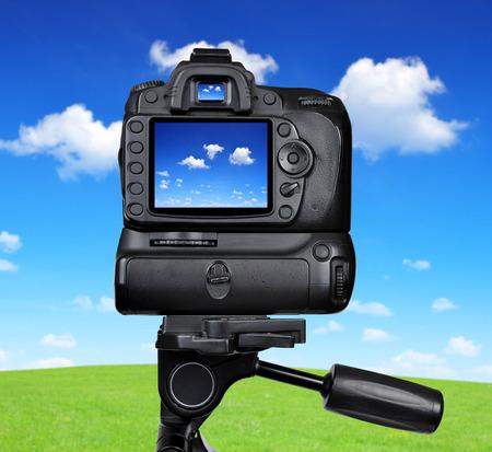 dslr camera: Dslr camera photographing blue sky