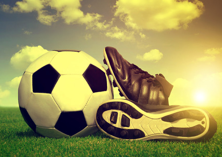 soccer cleats: Vintage soccer background with ball and cleats