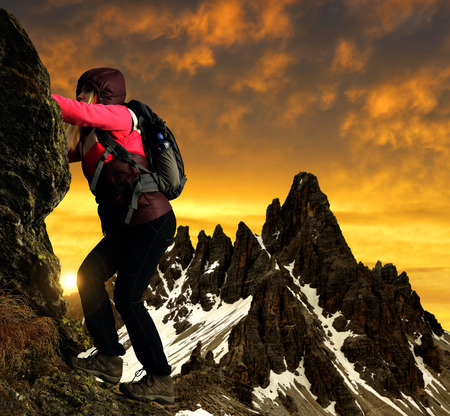 dolomite: Girl on rock, in the background mountain Paternkofel at sunset - Dolomite Alps,Italy Stock Photo