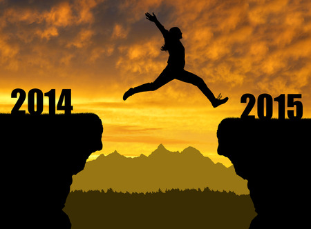 Girl jumps to the New Year 2015 photo