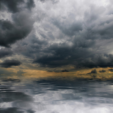 storm background: Storm clouds over sea. Natural background. Forces of nature concept.