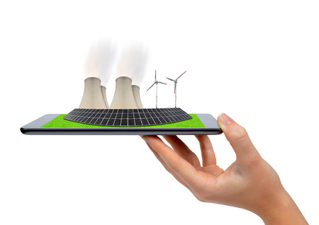 power in nature turbine: Hand holding digital tablet with a wind turbines, solar panel and nuclear power plant . Green energy concept.