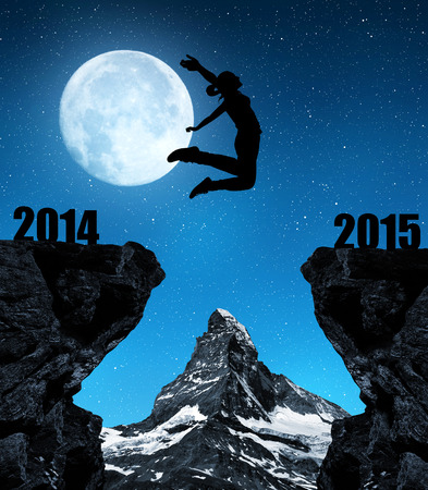 Girl jumps to the New Year 2015 in the background mount Matterhorn. photo