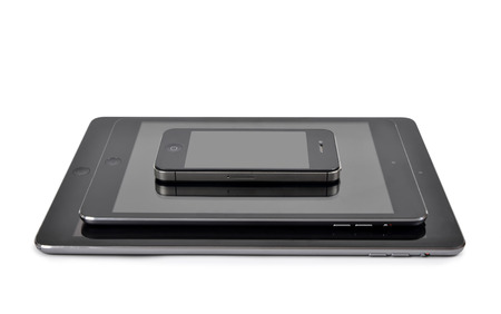 4s: Plzen,Czech Republic - October 11, 2014 : iPad air ,iPad mini and iPhone 4S Smart Phone developed by Apple Inc. Editorial