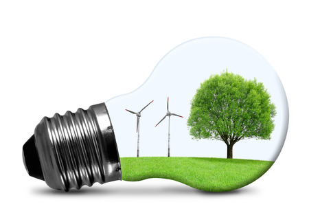 energy costs: Eco bulb with wind turbines and tree isolated on white