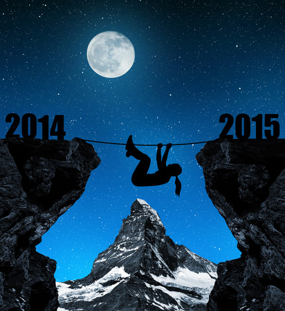 Girl climbs into the New Year 2015. In the background Matterhorn photo