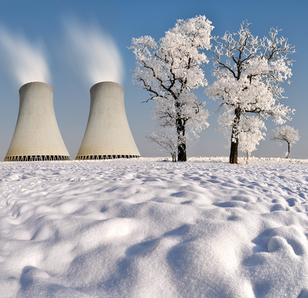 Nuclear waste: Winter landscape with nuclear power plant.