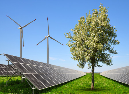 wind power plant: Solar energy panels with wind turbines in spring landscape