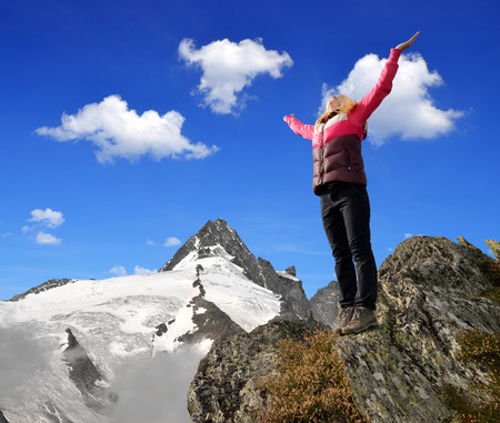 tauern: Girl on rock, in the background mount Grossglockner, National Park Hohe Tauern, Austria Stock Photo