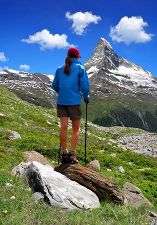 zermatt: Girl looking at the beautiful Mount Matterhorn in the Swiss Alps