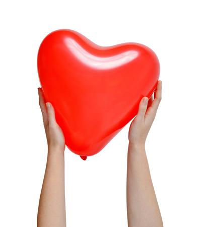 aide à la personne: Ballon au coeur de forme dans les mains