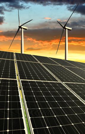 alternativ: Solar panels with wind turbines in the setting sun Stock Photo