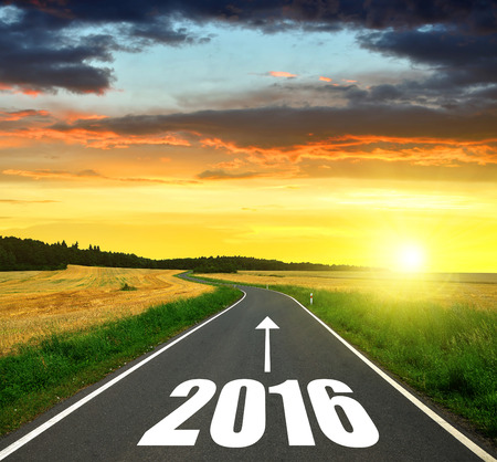 Asphalted road at sunset .Forward to the New Year 2016 Stock Photo