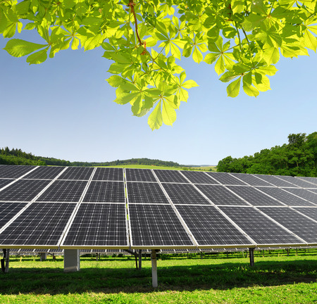 panel: Solar energy panels in spring landscape