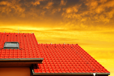 tiled: Roof house with tiled roof at sunset Stock Photo