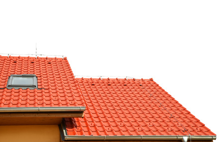 roofing: Roof house with tiled roof isolated on white background