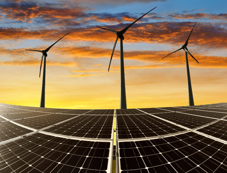 solar wind: Solar panels with wind turbines in the setting sun Stock Photo