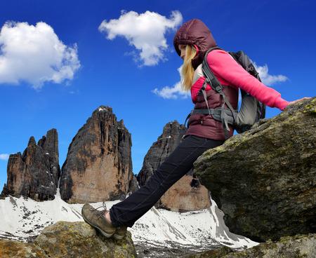 dolomite: Girl on rock, in the background Tre Cime di Lavaredo ,Dolomite Alps, Italy
